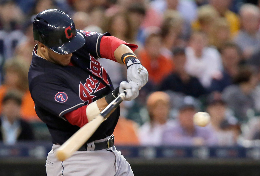 . Cleveland Indians\' Yan Gomes hits a fly ball against the Detroit Tigers for the third out of the seventh inning of a baseball game Friday, June 12, 2015, in Detroit. (AP Photo/Duane Burleson)