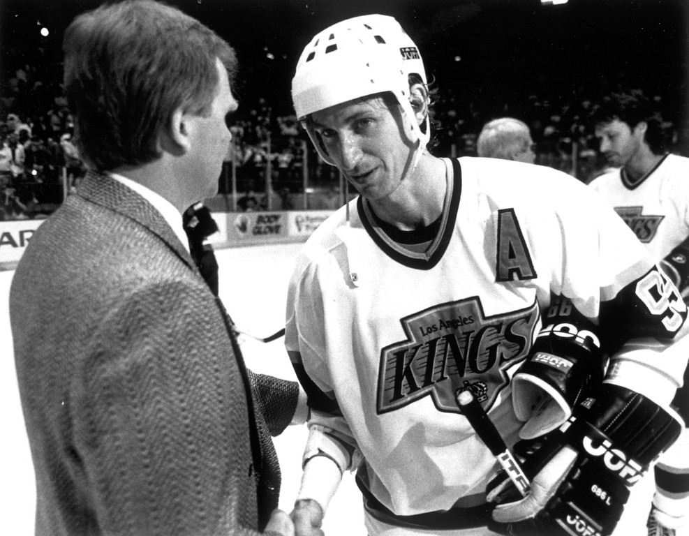 . Kings Wayne Gretzky shakes hands with Edmonton coach Glen Sather on April 15, 1989.  L.A. Daily News file photo