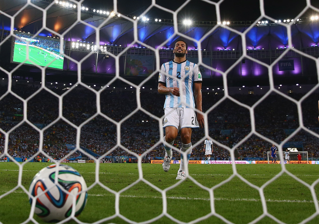 . Ezequiel Garay of Argentina looks on after Bosnia and Herzegovina\'s first goal during the 2014 FIFA World Cup Brazil Group F match between Argentina and Bosnia-Herzegovina at Maracana on June 15, 2014 in Rio de Janeiro, Brazil.  (Photo by Julian Finney/Getty Images)