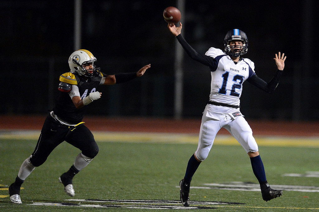 . Duarte quarterback Isaiah Scott (12) passes against Bassett in the first half of a prep football game at Bassett High School in La Puente, Calif., on Friday, Nov. 1, 2013.    (Keith Birmingham Pasadena Star-News)