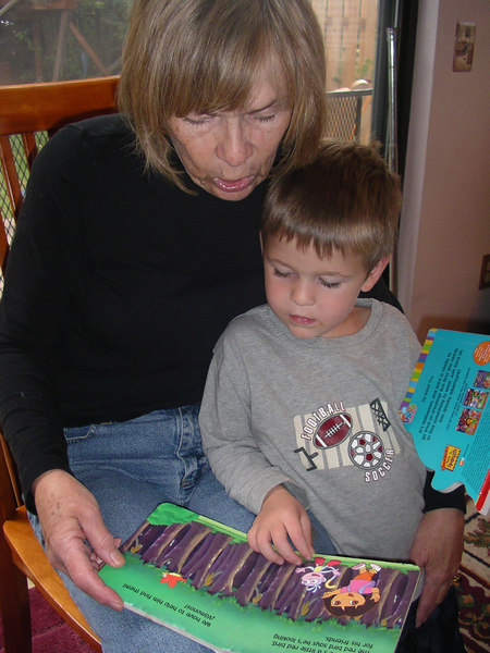Mom and Lucas reading a book. 