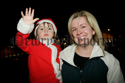 Guy Wallace (also known as mini santa) is pictured with his mum Serena at the switching of the Christmas lights in Newry on Thursday last. 06W48N13