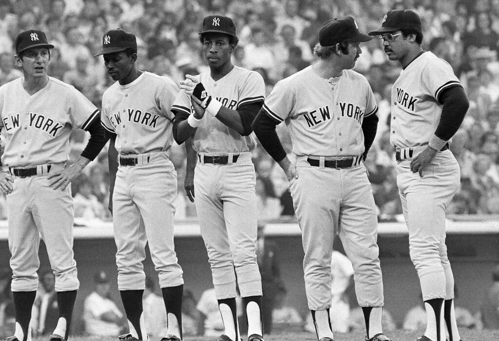. The New York Yankees are shown as they took the field when the lineups were announced, Oct. 15, 1977, in Los Angeles before the start of the third game in the World Series. From left, manager Billy Martin, center fielder Mickey Rivers, second baseman Willie Randolph, catcher Thurman Munson and right fielder Reggie Jackson. (AP Photo)