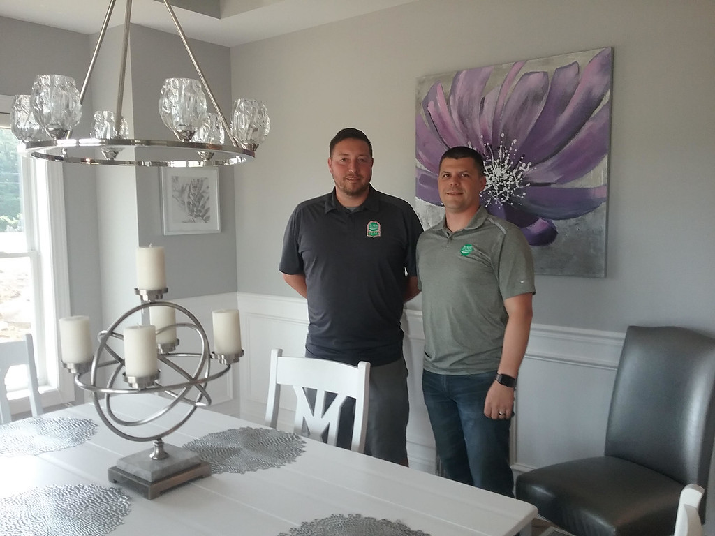 . huck McClintock (left), and Josh Edgell of JEMM Construction based in Painesville Township are pictured in the dining room of the 2018 Dream House in Mentor. JEMM Construction built the home. McClintock served as the project manager and Edgell is co-owner of the company. (Jean Bonchak)