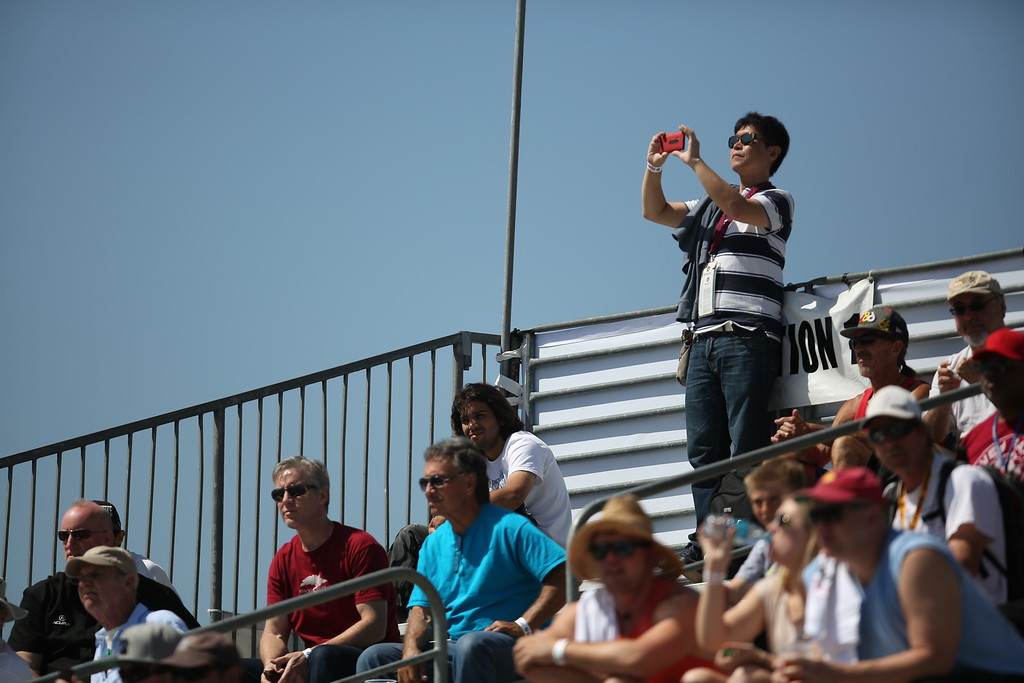 . Fans take in a day at the races at the 41st Toyota Grand Prix of Long Beach, Friday April 17th, 2015.  Chuck Bennett/Staff Photographer.
