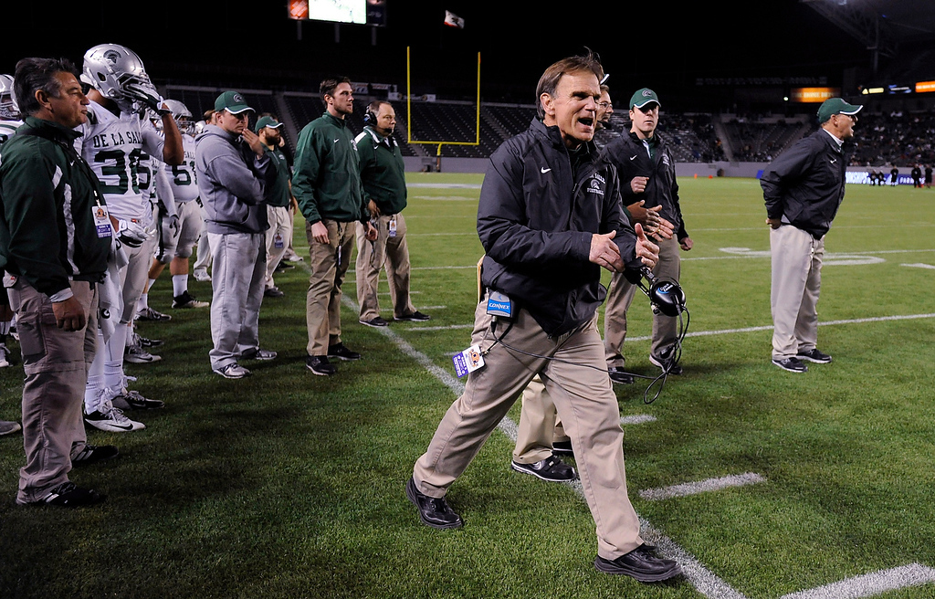 . De La Salle Spartans head coach Bob Ladouceur coaches from the sideline against the Centennial Huskies in the Open Division during the 2012 CIF State Football Championship at Home Depot Center in Carson , Calif. on Saturday, Dec. 15, 2012. De La Salle defeated Centennial 48-28. (Jose Carlos Fajardo/Staff)