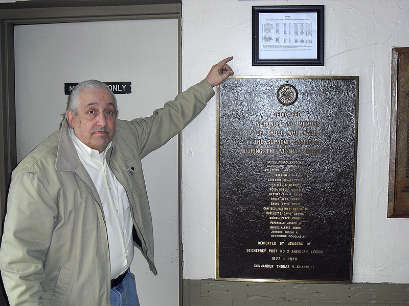 """Al """"Chops"""" Cianchetti Jr. points to a spreadsheet he made that lists all Bristol and Forestville service members who died in the Vietnam War. It lists each man's name, rank, age of death, date of death, branch and position on the Vietnam War Memorial Wall in Washington, DC. The memorial in Washington DC is called the Vietnam Veterans Memorial. It is sometimes referred to as """"the Wall"""". This is not a war Memorial but a Memorial to those who served in the war, both living and dead.  photo by Diane Church"""
