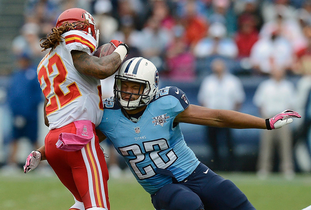 . Tennessee Titans running back Jackie Battle, right, hits Kansas City Chiefs wide receiver Dexter McCluster, left, in the first quarter of an NFL football game on Sunday, Oct. 6, 2013, in Nashville, Tenn. (AP Photo/Mark Zaleski)
