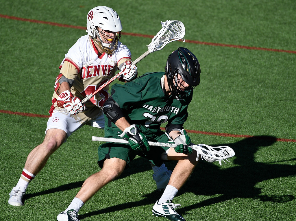 . DENVER, CO - FEBRUARY 28: Denver Christian Thomas (43) put pressure on Dartmouth Billy Heidt (20) in the fourth period during the Face-off Classic February 28, 2016 at Peter Barton Lacrosse Stadium. (Photo By John Leyba/The Denver Post)