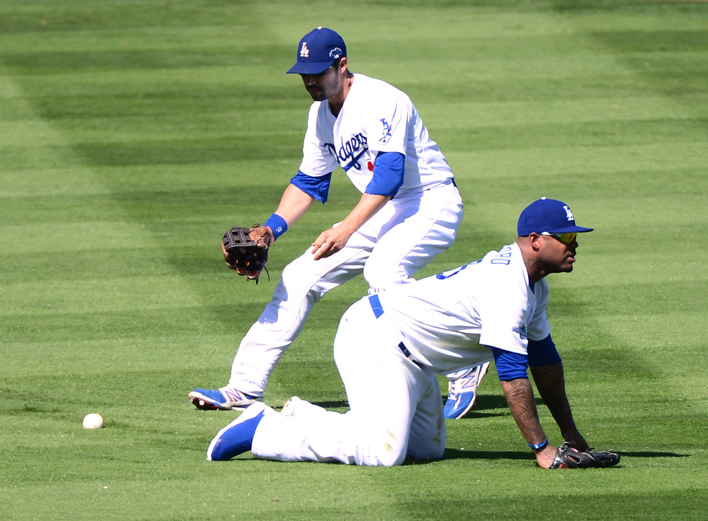 . The Dodgers\' Andre Ethier chases down the ball after Carl Crawford comes up short on a diving play against the Cardinals during game 5 of the NLCS at Dodger Stadium Wednesday, October 16, 2013.  The Dodgers won the game 6-4.(Photo by Sarah Reingewirtz/Los Angeles Daily News)