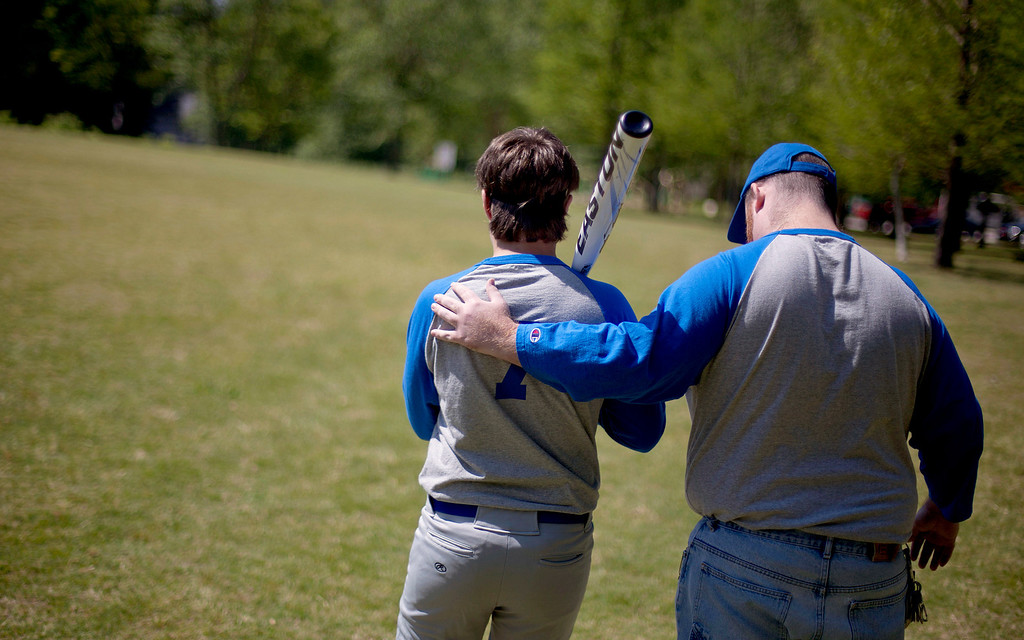 . Richard Sexton, left, is guided by John Steven to the batter\'s box during a blind baseball practice in Atlanta on April 14, 2012. (AP Photo/David Goldman)