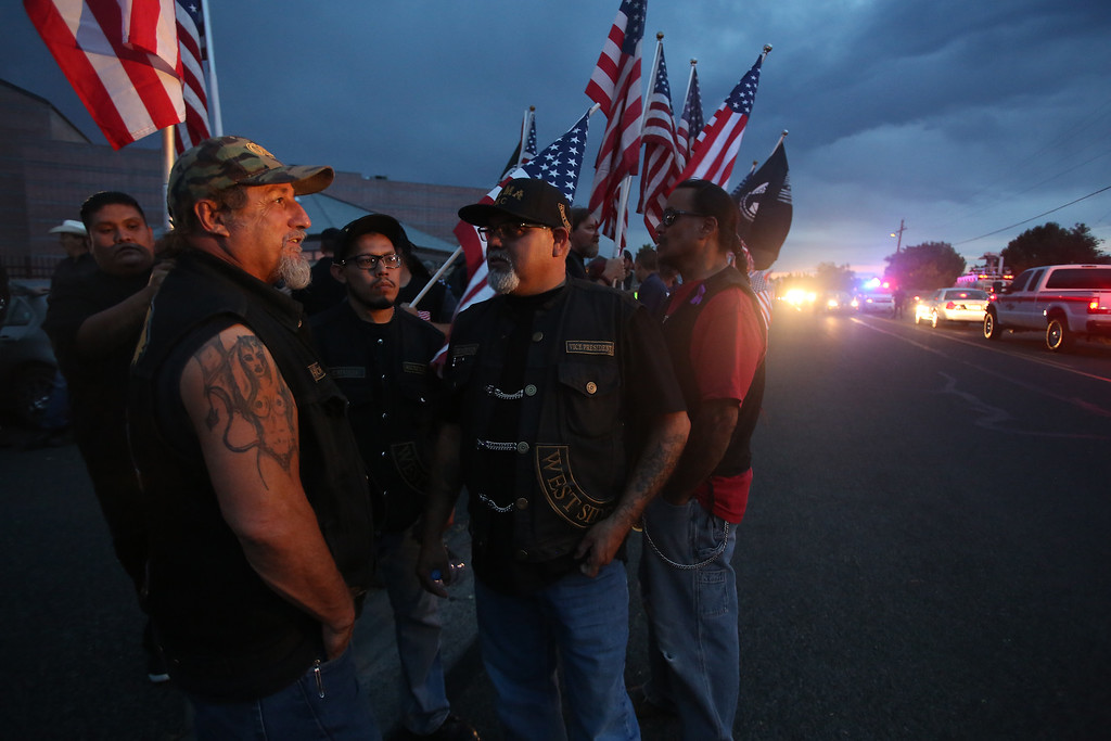 . (From left) Sea Horse, Chuco, Veneto and Ele stand outside the Prescott High School in Prescott, Arizona on July 2, 2013.  The US military on July 2 ordered four air tankers to join fire-dousing efforts in Arizona, where firefighters were battling a still out-of-control inferno which killed 19 of their comrades.  AFP PHOTO / KRISTA  Kennell/AFP/Getty Images