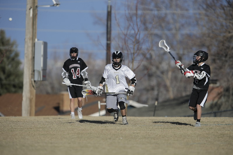 JPM0007-JPM0007-Jonathan first HS lacrosse game March 9th.jpg
