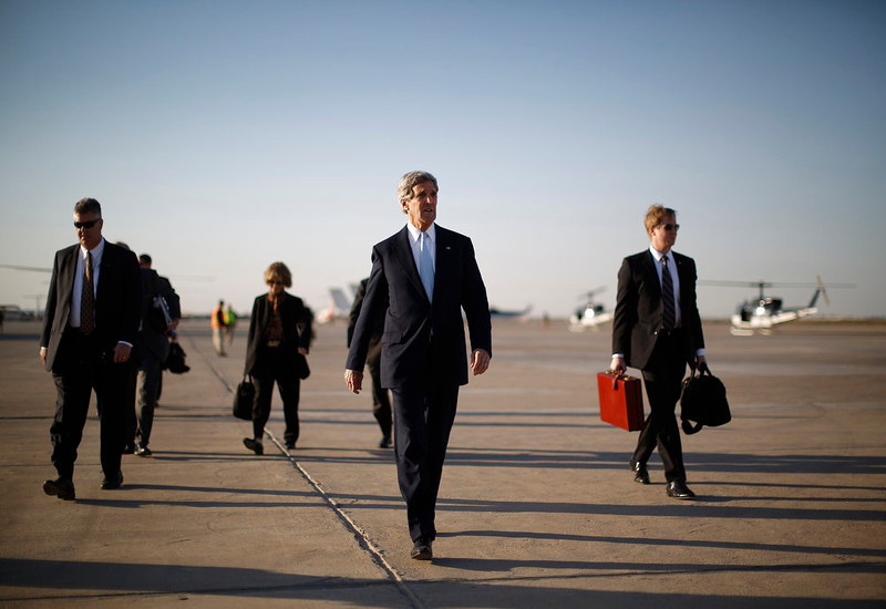 . U.S. Secretary of State John Kerry (2nd R) walks across the tarmac of Baghdad International Airport as he prepares to board an aircraft out of the Iraqi capital March 24, 2013. Kerry made an unannounced visit to Iraq on Sunday and said he told Prime Minister Nuri al-Maliki of his concern about Iranian flights over Iraq carrying arms to Syria.   REUTERS/Jason Reed