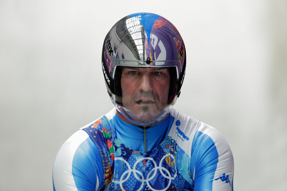 . Armin Zoeggler of Italy finishes a run during the Luge Relay on Day 6 of the Sochi 2014 Winter Olympics at Sliding Center Sanki on February 13, 2014 in Sochi, Russia.  (Photo by Adam Pretty/Getty Images)
