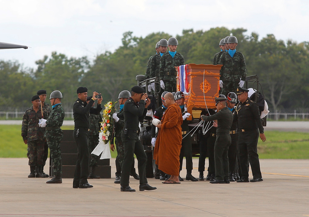 . The body of Saman Gunan, a former Thai navy SEAL who died during an overnight mission, is carried during a repatriation and religious rites ceremony at Chiang Rai Airport in Mae Sai, Chiang Rai province, in northern Thailand Friday, July 6, 2018. The Thai navy diver working as part of the effort to rescue 12 boys and their soccer coach trapped in a flooded cave died Friday from lack of oxygen, underscoring risks of extracting the team. (AP Photo)