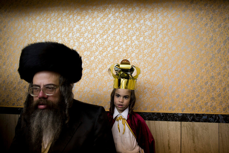 . An Ultra Orthodox Jewish child dresses like a King during prayers for the Jewish Holiday of Purim in the Mea Shaarim neighborhood in Jerusalem, Israel, 16 March 2014. The joyful Jewish holiday of Purim celebrates the Jews\' salvation from genocide in ancient Persia, as recounted in the Scroll of Esther.  (EPA/ABIR SULTAN)