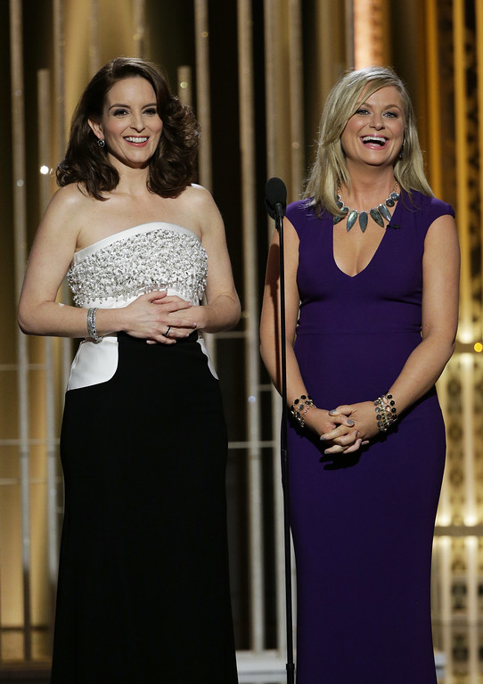 . BEVERLY HILLS, CA - JANUARY 11:  In this handout photo provided by NBCUniversal,  Hosts Tiny Fey and Amy Poehler speak onstage during the 72nd Annual Golden Globe Awards at The Beverly Hilton Hotel on January 11, 2015 in Beverly Hills, California.  (Photo by Paul Drinkwater/NBCUniversal via Getty Images)