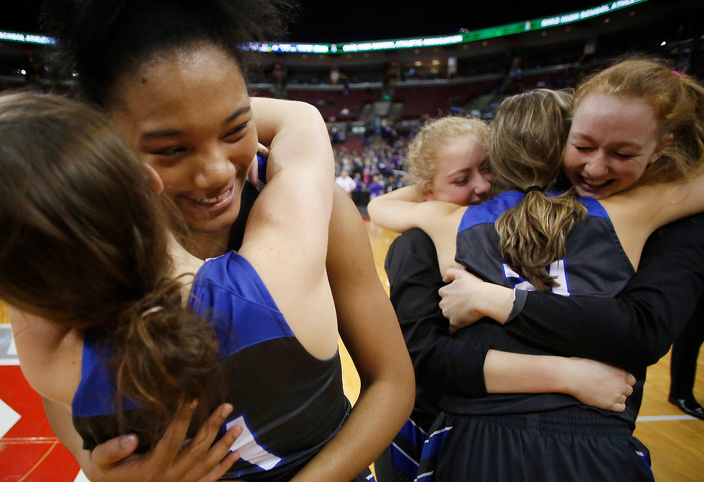. Gilmour Academy teammates Naz Hillmon (facing), and Annika Corcoran celebrate the narrow win over Bellbrook following action in the OHSAA division II state semi-final at Valu City Arena, Columbus.  The Lancers will take on Toledo Rogers for the state championship on Saturday.  (Photo By Joe Maiorana/ImpactActionPhotos.com)