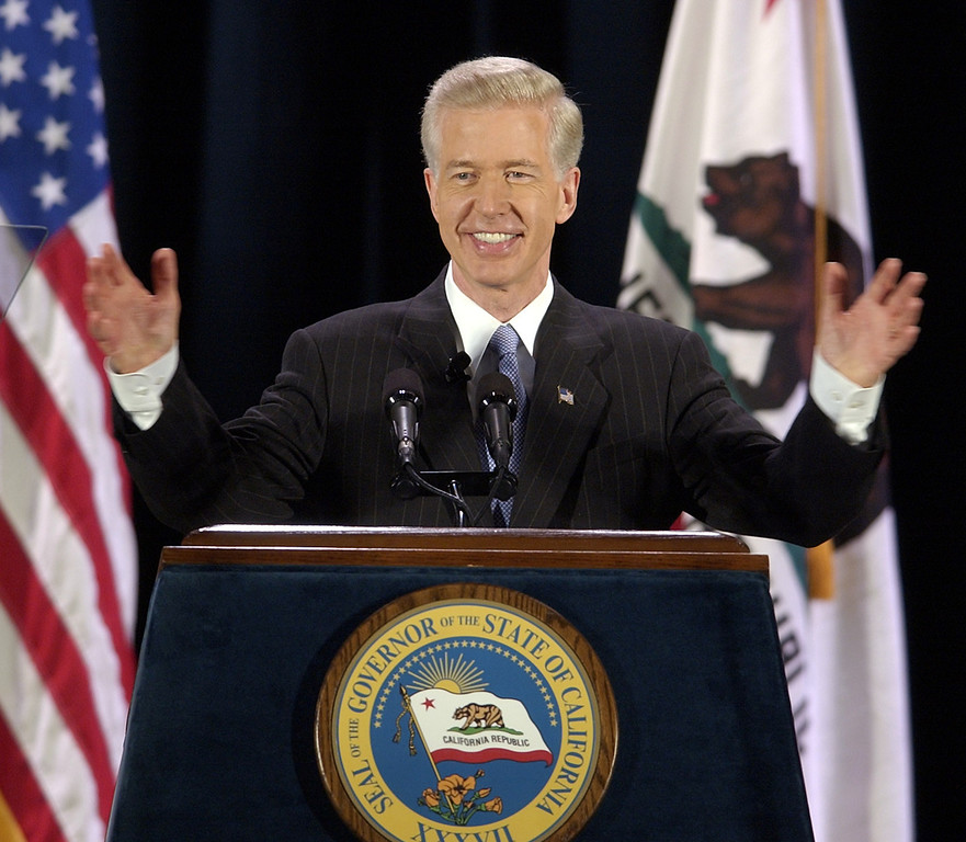". California Gov. Gray Davis waves his hands to a chorus of ""no recall\"" from the gathered crowd as he begins his first major address on the recall election aimed at removing him from office, Tuesday, Aug. 19, 2003, on the campus of UCLA in Los Angeles. (AP Photo/Reed Saxon)"