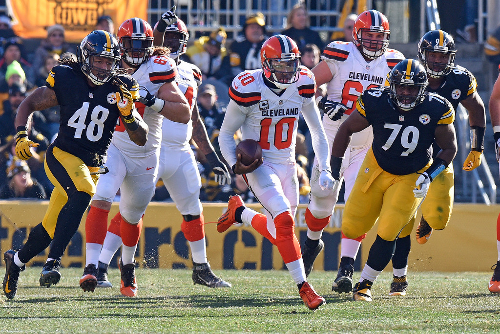 . Cleveland Browns quarterback Robert Griffin III (10) scrambles for a first down during the first half of an NFL football game against the Pittsburgh Steelers in Pittsburgh, Sunday, Jan. 1, 2017. (AP Photo/Don Wright)