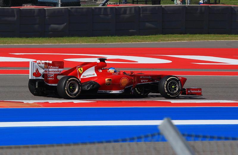 Fernando Alonso, Ferrari, in turn four.