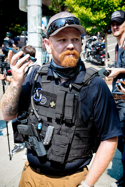 A far right member listens to his phone.