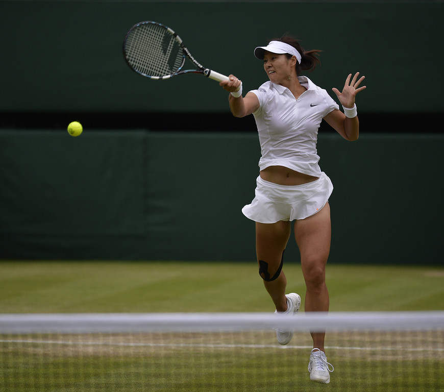 . China\'s Li Na returns against Poland\'s Agnieszka Radwanska during their women\'s singles quarter-final match on day eight of the 2013 Wimbledon Championships tennis tournament at the All England Club in Wimbledon, southwest London, on July 2, 2013. ADRIAN DENNIS/AFP/Getty Images
