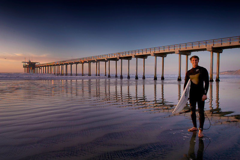 Yesterday I went down to Scripps Pier to take more shots of the pier at Sunset.  It was an absolutely gorgeous day again here in La Jolla and as I was walking to take some shots a couple of surfers asked me to take pictures of them.  Well they actually wanted shots of themselves surfing and unfortunately I only had my wider angle lenses and could never get in close enough to take good surfing pictures.   But they offered to take a few photos while they were heading out to surf.  I was really happy that they asked me to take pictures of them. I told them I would come back later and bring my zoom lenses to get pictures of them surfing later.  It was a really nice sunset and vibe on the beaches of La Jolla as it always is.