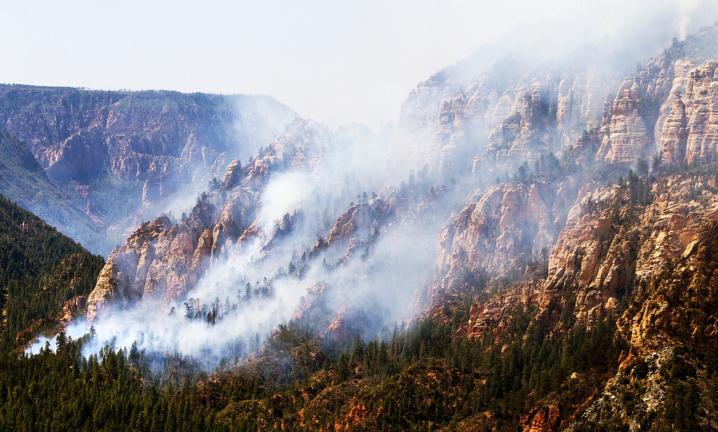 . The Slide Fire burns near 89 A south of Flagstaff, Wednesday, May 21, 2014.  Evacuations of surrounding areas took place late afternoon Tuesday. (AP Photo/The Arizona Republic, Tom Tingle)