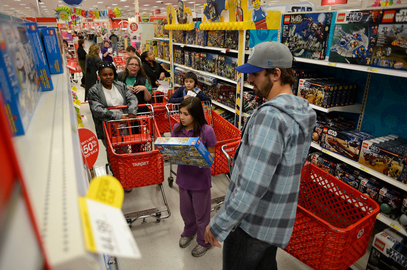 . Broncos wide receiver Eric Decker takes his group of kids from the Boys and Girls Club down the Lego isle. Decker and teammate Demaryius Thomas  and other Broncos reached  out to help children in their community by hosting a holiday shopping trip at Super Target Tuesday, December 11, 2012 in Lone Tree. 25 children, ranging in age from 8 to 14, are being rewarded for their outstanding participation in their after-school program with a trip to buy holiday presents. John Leyba, The Denver Post