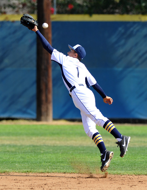 . California shortstop Anthony Von Slomski (#1) tries for a ball as they play Whittier in their Del Rio League game at California High School in Whittier on Friday March 22, 2013. California beat Whittier 6-0. (SGVN/Staff Photo by Keith Durflinger)