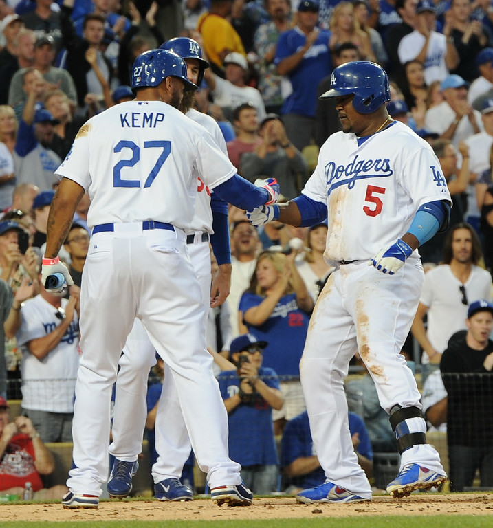 . Dodgers Juan Uribe is congratulated after he homered to score Matt Kemp and Scott Van Slyke in the 2nd inning. Angeles CA. 8/5/2014(Photo by John McCoy Daily News)