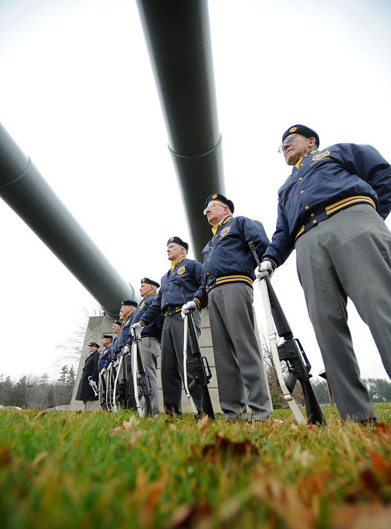 . The State College American Legion Post 245 honor guard stands at attention during a Pearl Harbor Remembrance Day and ceremony at the Pennsylvania Military Museum, in Boalsburg, Pa., Friday, Dec. 7, 2012. (AP Photo/Centre Daily Times, Centre Daily Times, Nabil K. Mark)