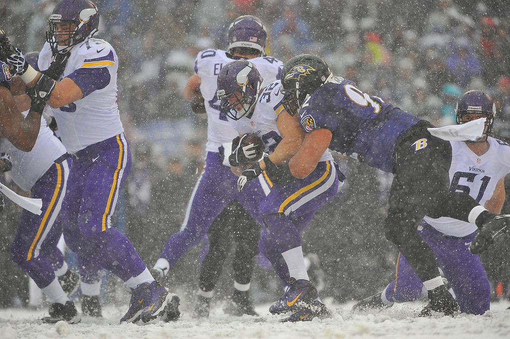 . Running back Toby Gerhart #32 of the Minnesota Vikings runs the ball against the Baltimore Ravens at M&T Bank Stadium on December 8, 2013 in Baltimore, Maryland. (Photo by Larry French/Getty Images)