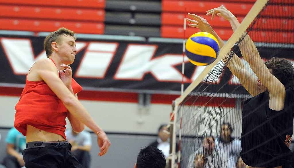 . LONG BEACH - 04/16/2013  (Photo: Scott Varley, Los Angeles Newspaper Group)  Long Beach City College defeated Orange Coast College to advance to the semifinal in the state mens volleyball playoffs. LBCC\'s Jake Burkhardt has his spike blocked at the net.
