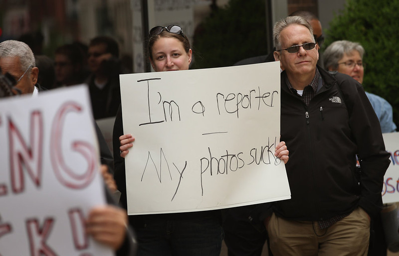 . Demonstrators, including union members, reporters, and photographers march outside the offices of the Chicago Sun-Times protesting the newspapers decision to eliminate its 28-member photography staff on June 6, 2013 in Chicago, Illinois. The newspaper chain plans to train their reporters to take pictures with iPhones to fill the void.  (Photo by Scott Olson/Getty Images)