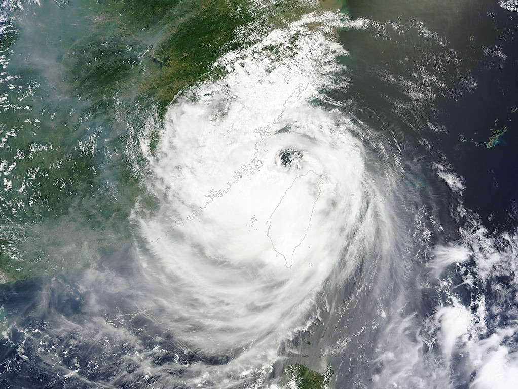 ". This NASA satellite image shows Typhoon Soulik  on July 13, 2013. Soulik made landfall on the northeast coast of Taiwan around 03:00 am July 13 (2000 GMT July 12), packing winds of up to 190 kilometres an hour (118 miles), the Central Weather Bureau (CWB) said. Soulik battered Taiwan with torrential rain and powerful winds on Saturday that left two people dead and at least 100 injured. Roofs were ripped from homes, debris and fallen trees littered the streets, and some areas were submerged by flood waters. One town in central Taiwan reported ""widespread\"" landslides and water levels a storey high. Around 8,000 people were evacuated from their homes before the typhoon struck, with hundreds of soldiers deployed to high-risk areas and the whole island declared an \""alert zone\"" by the authorities. AFP PHOTO / NASA"
