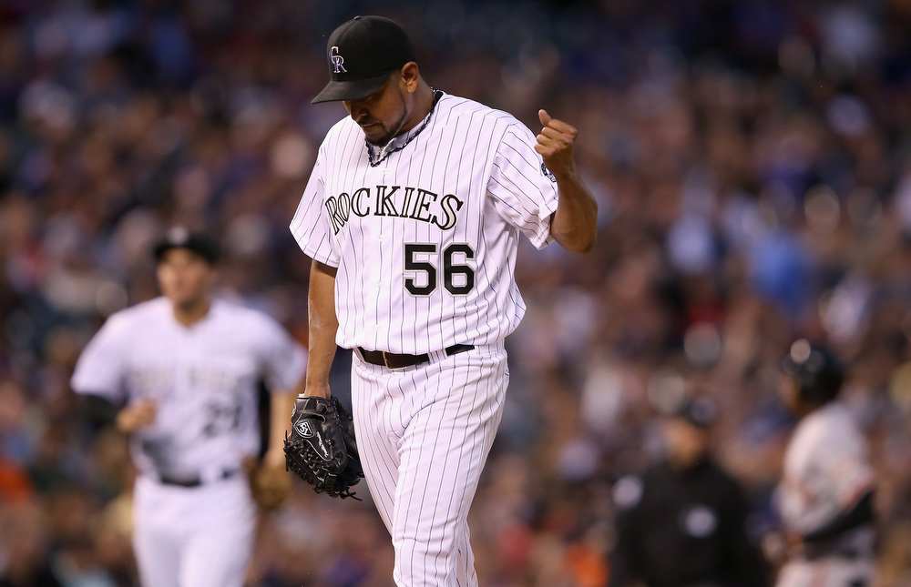 . Starting pitcher Franklin Morales #56 of the Colorado Rockies reacts as the fourth inning ends and the San Francisco Giants left two runners on base at Coors Field on April 22, 2014 in Denver, Colorado. Morales earned the win as the Rockies defeated the Gaints 2-1.  (Photo by Doug Pensinger/Getty Images)