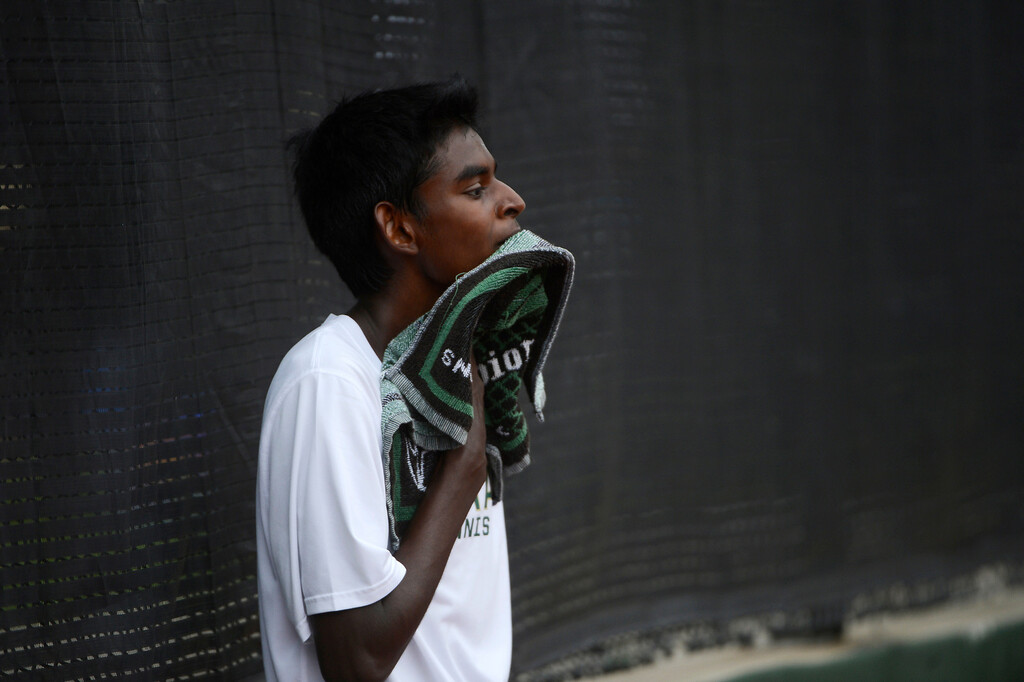 . DENVER, CO - OCTOBER 11:   Vignesh Senthivel, Mountain Vista  High School, wipes his face in between points against Zach Fryer, Cherry Creek High School, (not pictured) during their #1 semi-final match at the 2013 State 5A Tennis Championships at the Gates Tennis Center in Denver, Colorado Friday morning, October 11, 2013. (Photo By Andy Cross/The Denver Post)