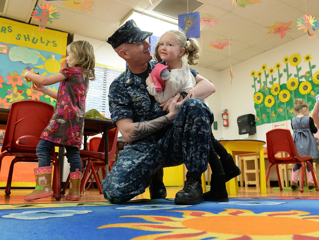 . Navy Chief Nick Elliot hugs his daughter Alexis, 4, after surprising her inside her preschool classroom at First Lutheran Children\'s Center in Redlands,CA. Thursday, Nov. 21, 2013. Elliots was deployed overseas for eight months, serving in the Persian Golf on the USS Harry S. Truman, this has been the longest he has ever been away from his family. (John Valenzuela/Staff Photographer)