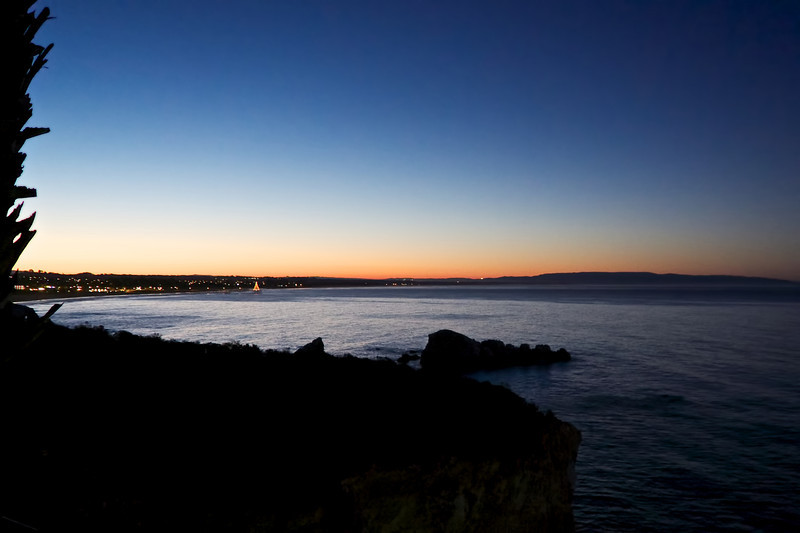 Sunrise looking onto the Pismo Beach Pier from Sheltered Cove. 