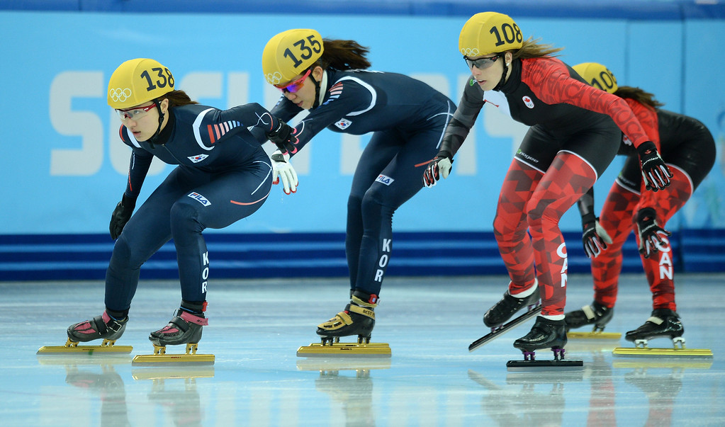 . (L-R) South Korea\'s Park Seunghi, South Korea\'s Cho Ha-Ri, Canada\'s Marianne St-Gelais and Canada\'s Jessica Hewitt compete in the Women\'s Short Track 3000 m Relay Semifinals at the Iceberg Skating Palace during the Sochi Winter Olympics on February 10, 2014.   JUNG YEON-JE/AFP/Getty Images