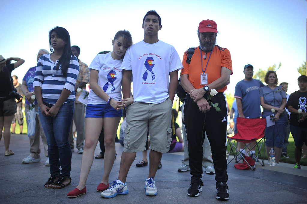 . AURORA, CO. - July 20: People gathered outside the Aurora Municipal Center to mark the first anniversary of the deaths of 12 people and the injury of at least 70 others in a mass shooting that forever changed an entire community. Aurora, Colorado. July 20, 2013.  (Photo By Hyoung Chang/The Denver Post)