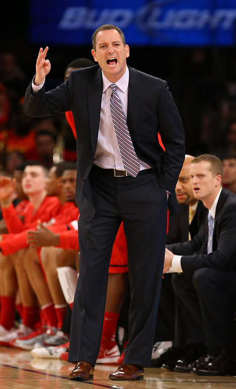. Head coach Mike Rice of the Rutgers Scarlet Knights shouts instructions to his team against Notre Dame Fighting Irish during the second round of the Big East Tournament at Madison Square Garden on March 13, 2013 in New York City.  (Photo by Al Bello/Getty Images)