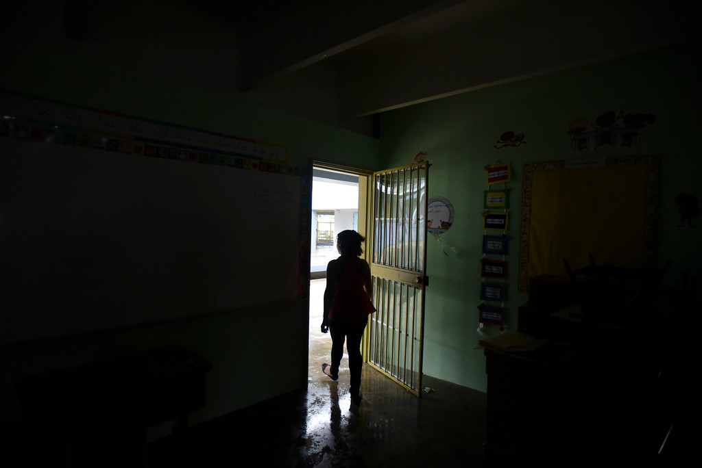. A woman looks outside from a shelter set up at the Berta Zalduondo elementary school during the passage of Hurricane Irma in Fajardo, northeastern Puerto Rico, Wednesday, Sept. 6, 2017. Heavy rain and high winds lashed Puerto Rico�s northeast coast Wednesday as Hurricane Irma roared through Caribbean islands. (AP Photo/Carlos Giusti) NO PUBLICAR EN PUERTO RICO