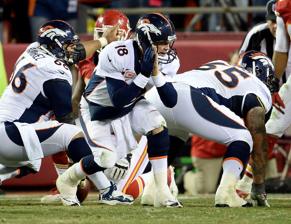 . Denver Broncos quarterback Peyton Manning (18) changes up the play at the line of scrimmage during the fourth quarter against the Kansas City Chiefs on Dec.1, 2013 at Arrowhead Stadium.  (Photo by John Leyba/The Denver Post)