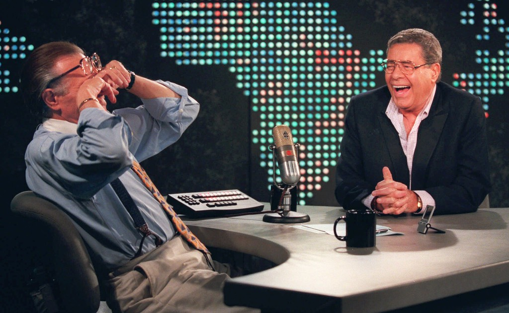 ". Talk show host Larry King wipes his eyes after laughing at a joke by comedy legend Jerry Lewis, Thursday, Aug. 26, 1999, on the set of ""Larry King Live\"" at CNN Studios in the Hollywood section of Los Angeles. (AP Photo/Chris Pizzello)"