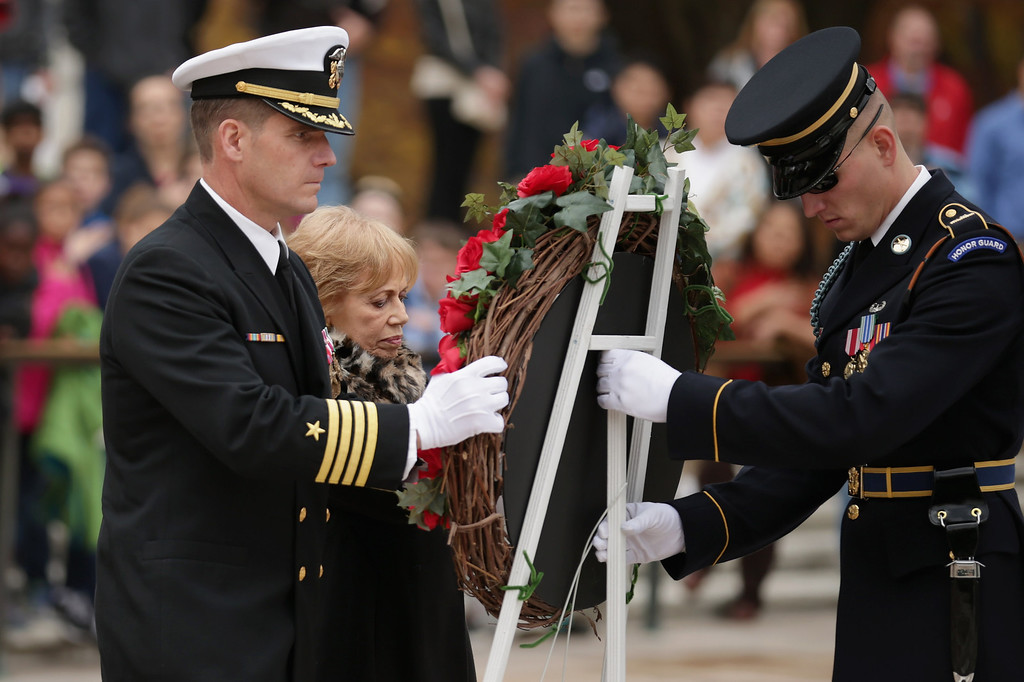 . Accompanied by members of the U.S. Navy SEALs, Carmella LaSpada (C), White House Special Projects Aide to President John F. Kennedy, participates in a wreath laying ceremony at the Tomb of the Unknowns in honor of Kennedy at Arlington National Cemetery November 22, 2013 in Arlington, Virginia.   (Photo by Chip Somodevilla/Getty Images)