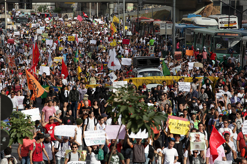 . Hundreds of people march during a protest at the Antonio Carlos Avenue, next to Mineirao stadium which hosts the Confederations Cup, on June 17, 2013, in Belo Horizonte, state of Minas Gerais. Tens of thousands of people took to the streets of major Brazilian cities protesting the billions of dollars spent on the Confederations Cup --and preparations for the upcoming World Cup-- and against the hike in mass transit fares.   BERNARDO SALCE/AFP/Getty Images